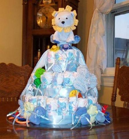 ... step by step instructions of how to make a diaper cake | Source Link