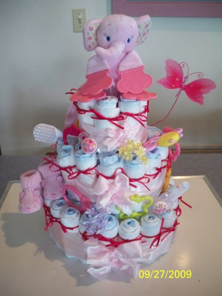 Its a girl diaper cake very precious for Baby shower cake decoration idea