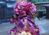 purple diaper cake