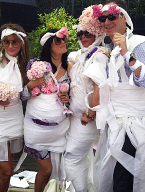 Victoria Beckham and Friends dress up in toilet paper dresses